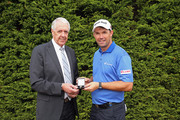 (L-R) PGA Captain Nicky Lumb presents Padraig Harrington of Ireland with with the Tooting Bec medal  for his third round 65 at the 2015 Open Championshjip following  practice for the British Masters supported by Sky Sports at Woburn Golf Club on October 6, 2015 in Woburn, England.