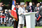 Prime Minister, Theresa May speaks at a memorial service in Bayeux Cemetery on June 06, 2019 in Bayeux, France. Veterans and families gathered in Normandy to commemorate D-Day's 75th anniversary. It has been announced that 16 countries had signed a historic proclamation of peace to ensure the horrors of the Second World War are never repeated. The text has been agreed by Australia, Belgium, Canada, Czech Republic, Denmark, France, Germany, Greece, Luxembourg, Netherlands, Norway, New Zealand, Poland, Slovakia, the United Kingdom and the United States of America.