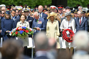 (L-R) Secretary of State for Defence Penny Mourdaunt, French Minister of the Armed Forces Florence Parly, Prince Charles, Prince of Wales, Camilla, Duchess of Cornwall, Prime Minister, Theresa May and Philip May attend a memorial service in Bayeux Cemetery on June 06, 2019 in Bayeux, France. Veterans and families gathered in Normandy to commemorate D-Day's 75th anniversary. It has been announced that 16 countries had signed a historic proclamation of peace to ensure the horrors of the Second World War are never repeated. The text has been agreed by Australia, Belgium, Canada, Czech Republic, Denmark, France, Germany, Greece, Luxembourg, Netherlands, Norway, New Zealand, Poland, Slovakia, the United Kingdom and the United States of America.