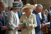 Camilla, Duchess of Cornwall (2nd,R) talks to British Prime Minister Theresa May as they attend the Royal British Legion Service of Remembrance at Bayeux Cathedral, as part of commemorations for the 75th anniversary of the D-Day landings on June 6, 2019 in Bayeux, France. Veterans, families, visitors, political leaders and military personnel are gathering in Normandy to commemorate D-Day, which heralded the Allied advance towards Germany and victory about 11 months later.