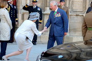 Britain's Prime Minister, Theresa May courtesy's for Prince Charles, Prince of Wales outside Bayeux Cathedral  on June 06, 2019 in Bayeux, France. Veterans, families, visitors, political leaders and military personnel are gathering in Normandy to commemorate D-Day, which heralded the Allied advance towards Germany and victory about 11 months later.