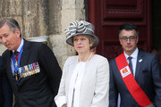 Britain's Prime Minister, Theresa May departs Bayeux Cathedral on June 06, 2019 in Bayeux, France. Veterans, families, visitors, political leaders and military personnel are gathering in Normandy to commemorate D-Day, which heralded the Allied advance towards Germany and victory about 11 months later.