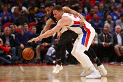 Blake Griffin #23 of the Detroit Pistons battles for a loose ball with Allen Crabbe #33 of the Brooklyn Nets during the second half at Little Caesars Arena on February 7, 2018 in Detroit, Michigan. NOTE TO USER: User expressly acknowledges and agrees that, by downloading and or using this photograph, User is consenting to the terms and conditions of the Getty Images License Agreement.