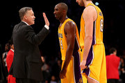 Head coach Mike D'Antoni of the Los Angeles Lakers celebrates with Kkobe Bryant #24 and Pau Gasol #16 after the game against the Brooklyn Nets at Staples Center on November 20, 2012 in Los Angeles, California. The Lakers won 95-90.   NOTE TO USER: User expressly acknowledges and agrees that, by downloading and or using this photograph, User is consenting to the terms and conditions of the Getty Images License Agreement.