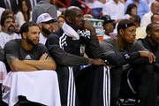 Deron Williams #8, Kevin Garnett #2 and Paul Pierce #34 of the Brooklyn Nets look on during Game One of the Eastern Conference Semifinals of the 2014 NBA Playoffs against the Miami Heat at American Airlines Arena on May 6, 2014 in Miami, Florida. NOTE TO USER: User expressly acknowledges and agrees that, by downloading and/or using this photograph, user is consenting to the terms and conditions of the Getty Images License Agreement. Mandatory copyright notice: