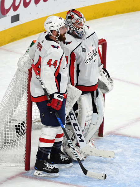 2018 NHL Stanley Cup Final - Game Five [player,college ice hockey,sports gear,ice hockey position,sports,hockey protective equipment,ice hockey,goaltender,team sport,ice hockey equipment,brooks orpik,braden holtby,five,las vegas,nevada,nhl,washington capitals,vegas golden knights,stanley cup final,game]