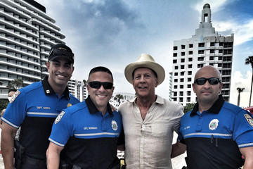 Bruce Willis Bruce Willis Poses With Miami Beach Police Officers During A Break In Filming