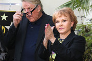 Actor Gary Busey (L) and Maria Elena Holly pose for photographers during the ceremony for recording artist Buddy Holly's posthumous star on the Hollywood Walk of Fame on September 7, 2011 in Hollywood, California.