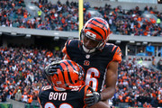 Tyler Boyd #83 of the Cincinnati Bengals is congratulated by James Wright #86 of the Cincinnati Bengals after scoring a touchdown during the second quarter of the game against the Buffalo Bills at Paul Brown Stadium on November 20, 2016 in Cincinnati, Ohio.