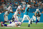 Quarterback David Fales #9 of the Miami Dolphins is pressured during the fourth quarter against the Buffalo Bills at Hard Rock Stadium on December 31, 2017 in Miami Gardens, Florida.