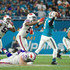 David Fales Photos - Quarterback David Fales #9 of the Miami Dolphins is pressured during the fourth quarter against the Buffalo Bills at Hard Rock Stadium on December 31, 2017 in Miami Gardens, Florida. - Buffalo Bills v Miami Dolphins