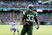 Chris Ivory #33 of the New York Jets scores a touchdown against the Buffalo Bills and  Nigel Bradham #53 in the second quarter at MetLife Stadium on October 26, 2014 in East Rutherford, New Jersey.