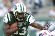 Running back Chris Ivory #33 of the New York Jets carries the ball in the 1st half of the Jets game against the Buffalo Bills at MetLife Stadium on September 22, 2013 in East Rutherford, New Jersey.