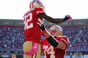 Wide receiver Mario Manningham #82 of the San Francisco 49ers celebrates a touchdown catch in the arms of tackle Joe Staley #74 against the Buffalo Bills in the fourth quarter on October 7, 2012 at Candlestick Park in San Francisco, California.  The 49ers won 45-3.