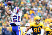 Jordan Poyer #21 of the Buffalo Bills intercepts a pass thrown by Aaron Rodgers #12 of the Green Bay Packers in front of Jimmy Graham #80 during the second quarter of a game at Lambeau Field on September 30, 2018 in Green Bay, Wisconsin.