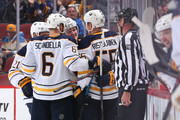 Kyle Okposo #21, Marco Scandella #6, Casey Mittelstadt #37, Jeff Skinner #53 and Rasmus Ristolainen #55 of the Buffalo Sabres celebrate after Skinner scored a goal against the Arizona Coyotes during the third period of the NHL game at Gila River Arena on October 13, 2018 in Glendale, Arizona. The Sabres defeated the Coyotes 3-0.