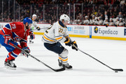 Johan Larsson #22 of the Buffalo Sabres skates the puck against Andrei Markov #79 of the Montreal Canadiens during the NHL game at the Bell Centre on February 3, 2016 in Montreal, Quebec, Canada.