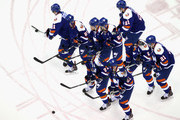 This image was created with multiple in-camera exposures) Kyle Okposo #21 of the New York Islanders skates in warm-ups prior to the game against the Buffalo Sabres at the Nassau Veterans Memorial Coliseum on April 4, 2015 in Uniondale, New York. The Islanders shut out the Sabres 3-0.