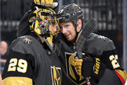 Marc-Andre Fleury #29 and Shea Theodore #27 of the Vegas Golden Knights celebrate on the ice after the team's 4-1 victory over the Buffalo Sabres at T-Mobile Arena on October 16, 2018 in Las Vegas, Nevada. .