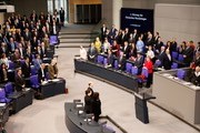 German Chancellor Angela Merkel (2ndR) stabnds next to German Vice Chancellor and Foreign Minister Sigmar Gabriel at the opening of a session at the Bundestag lower house of Parliament, on November 21, 2017 in Berlin. / AFP PHOTO / Odd ANDERSEN