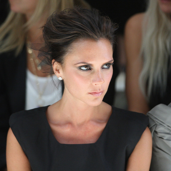 Victoria Beckham watches the Burberry Prorsum Spring/Summer 2010 Show at