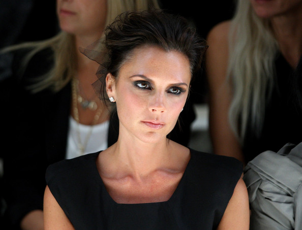 Victoria Beckham Victoria Beckham watches the Burberry Prorsum Spring/Summer 2010 Show at Rootstein Hopkins Parade Ground during London Fashion Week on September 22, 2009 in London, England.