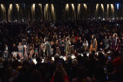 (L-R) Susanne Wuest, Raya Abirached, Nadine Labaki, Kim Min Hee, Lily Donaldson, Paloma Faith, Clemence Posey, Maggie Gyllenhaal, Sam Smith, Cara Delevingne, Jourdan Dunn, Kate Moss, Mario Testino and Naomi Campbell attend the Burberry Prorsum AW 2015 show during London Fashion Week at Kensington Gardens on February 23, 2015 in London, England.