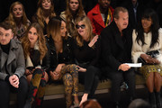 (L-R) Sam Smith, Cara Delevingne, Jourdan Dunn, Kate Moss, Mario Testino and Naomi Campbell attend the Burberry Prorsum AW 2015 show during London Fashion Week at Kensington Gardens on February 23, 2015 in London, England.