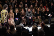 (L-R) Paloma Faith, Clemence Posey, Maggie Gyllenhaal, Sam Smith, Cara Delevingne, Jourdan Dunn, Kate Moss and Mario Testino attend the Burberry Prorsum AW 2015 show during London Fashion Week at Kensington Gardens on February 23, 2015 in London, England.