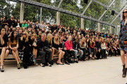 (L to R) Zhang Zilin, Go So Yung, Laura Bailey, Paul Weller, Poppy Delevingne, Lily Donaldson, Dan Gillespie, Ellie Goulding, Kanye West, Sienna Miller, Gemma Arterton, Rosie Huntington-Whiteley, Mario Testino, Andy Murray, Kim Sears and Douglas Booth attend at the Burberry Spring Summer 2012 Womenswear Show at Kensington Gardens on September 19, 2011 in London, England.