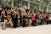 (L to R) Zhang Zilin, Go So Yung, Rachel Zoe, Laura Bailey, Paul Weller, Poppy Delevingne, Lily Donaldson, Dan Gillespie, Ellie Goulding, Kanye West, Sienna Miller, Gemma Arterton, Rosie Huntington-Whiteley, Mario Testino, Andy Murray, and Kim Sears attend at the Burberry Spring Summer 2012 Womenswear Show at Kensington Gardens on September 19, 2011 in London, England.