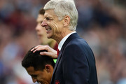 Arsene Wenger, Manager of Arsenal celebrates his teams win with Santi Cazorla during the Premier League match between Burnley and Arsenal at Turf Moor on October 2, 2016 in Burnley, England.