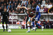 David Jones of Burnley battles with Toumani Diagouraga of Brentford during the Sky Bet Championship match between Burnley and Brentford at Turf Moor on August 22, 2015 in Burnley, England.