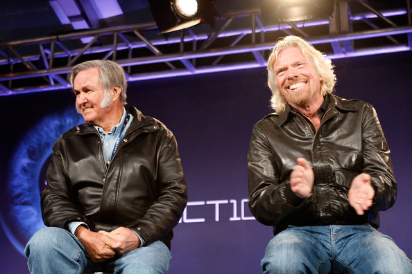 Virgin Galactic's SpaceShipTwo, First Commercial Spacecraft, Unveiled In CA [cheek,event,performance,human,fun,photography,conversation,sitting,stage,performing arts,richard branson,burt rutan,spaceshiptwo,ca,spacecraft,mojave spaceport,virgin galactic,first commercial spacecraft,the spaceship company,l]