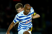 Karl Henry of QPR holds off the challenge of Matty Palmer of Burton during the Capital One Cup Second Round match between Burton Albion and Queens Park Rangers at Pirelli Stadium on August 27, 2014 in Burton-upon-Trent, England.