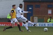 Kelvin Ethuhu of Bury has a shot at goal to score his sides 1st goal during the Sky Bet League Two match between Bury and Northampton Town at The JD Stadium on March 21, 2015 in Bury, England.