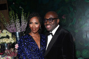 Tiwa Savage and Edward Enninful at the gala dinner in honour of Edward Enninful, winner of the Global VOICES Award 2019, during #BoFVOICES on November 22, 2019 in Oxfordshire, England.