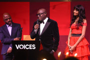 Duro Olowu (L) and Jourdan Dunn present Edward Enninful with the Global VOICES Award 2019, during the gala dinner at #BoFVOICES on November 22, 2019 in Oxfordshire, England.