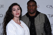 """Dancer Lilit Avagyan (L) and her husband, running back Reggie Bush of the Detroit Lions, arrive at """"LIV on Sundays"""" presented by TAO Takeover Party at CAKE Nightclub on February 1, 2015 in Scottsdale, Arizona."""
