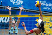 Bárbara Seixas (L) and Juliana (R) in action during the CBBVP Open Beach Volleyball - Final at Enseada Beach on November 17, 2013 in Guaruja, Brazil.
