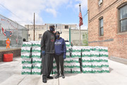 (L-R) Former professional baseball player CC Sabathia and his wife, PitCCh In Foundation Co Founder and Executive Director Amber Sabathia distribute pantry boxes to Boys And Girls Club families at the Belmont Community Day Care Center on April 08, 2020 in The Bronx Borough of New York City.