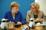 German Chancellor and leader of the German Chistian Democrats (CDU) Angela Merkel (L) chats with colleague Julia Kloeckner prior to an early morning meeting of the CDU governing board on July 2, 2018 in Berlin, Germany. German Interior Minister and leader of the Bavarian sister party of the CDU, the CSU, Horst Sehhofer, had announced he will resign yesterday from both posts over what he sees as insufficient policy by Merkel over asylum and migraiton policy. He then announced he will postpone his resignation in order to meet with Merkel later today.