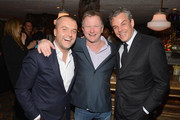 (L-R) COO of Soho House Martin Kuczmarsk, Founder of Soho House Nick Jones and actor Danny Huston attend a dinner and auction hosted by CHANEL to benefit the Henry Street Settlement at Soho Beach House on December 5, 2012 in Miami Beach, Florida.