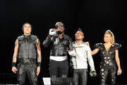 """Taboo, will.i.am, apl.de.ap and Fergie of the Black Eyed Peas   perform onstage during CHASE Presents The Black Eyed Peas and Friends """"Concert 4 NYC"""" benefiting the Robin Hood Foundation at Central Park, Great Lawn on September 30, 2011 in New York City."""