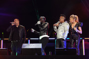 """Dante Santiago and will.i.am, apl.de.ap, and Fergie of The Black Eyed Peas perform onstage during CHASE Presents The Black Eyed Peas and Friends """"Concert 4 NYC"""" benefiting the Robin Hood Foundation at Central Park, Great Lawn on September 30, 2011 in New York City."""