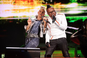 """Fergie and apl.de.ap of The Black Eyed Peas perform onstage during CHASE Presents The Black Eyed Peas and Friends """"Concert 4 NYC"""" benefiting the Robin Hood Foundation at Central Park, Great Lawn on September 30, 2011 in New York City."""