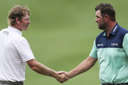 Brandt Snedeker (L) of the United States shakes hands with Marc Leishman of Australia after round two of the CIMB Classic at TPC Kuala Lumpur on October 12, 2018 in Kuala Lumpur, Malaysia.