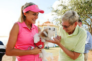 Lexi Thompson and her dog, Leo, greet a fan after her practice round in preparation for the LPGA CME Group Tour Championship at Tiburon Golf Club on November 14, 2018 in Naples, Florida.