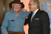 Singer-songwriter Billy Joe Shaver (L) and Director and CEO of the Country Music Hall of Fame and Museum Kyle Young (R) attend the CMHOF Outlaws and Armadillos VIP Opening Reception on May 24, 2018 in Nashville, Tennessee.