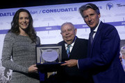 IAAF President Sebastian Coe, CONSULDATE President Robert Gesta De Melo and Fabiana Murer of Brazil during the CONSULDATE Centenary Dinner and Show on July 27, 2018 in Buenos Aires, Argentina.